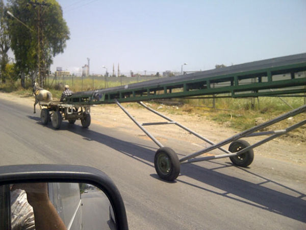 Interesting juxtaposition of technology seen near Mersin port — a horse-drawn conveyer belt!
