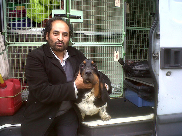 Cuddly eight-month-old Basset Hound Darwin with his proud new owner. There are six other Bassets waiting to greet him at his new home! Darwin is from a champion bloodline — his dad became a Portuguese champion just this weekend.