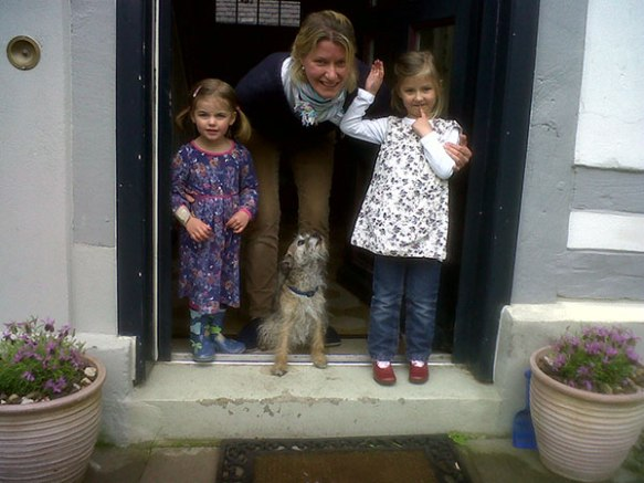 Fudge with his family — both little girls were very excited to have their favourite playmate back and immediately started a game of tag