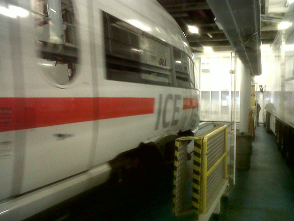 On board the ferry from Denmark to Germany — a train driving up alongside her rather spooked courier S!