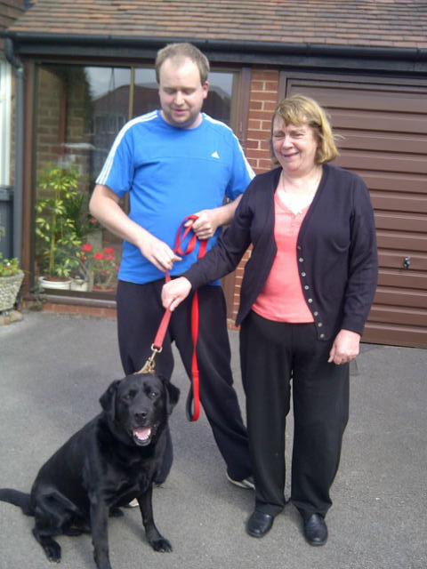 Shiny, handsome Winston with his owners Chris and Jane