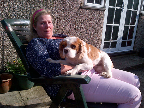 Sunbathing with Angel who does love a lap to sit on!