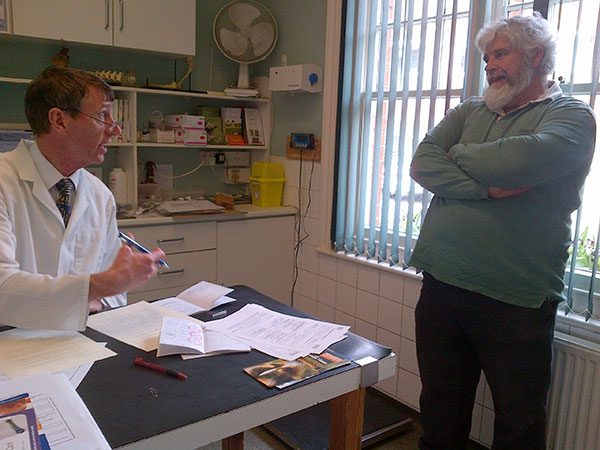 Mr Dibble is known for his thoroughness — here he is talking things through with courier M