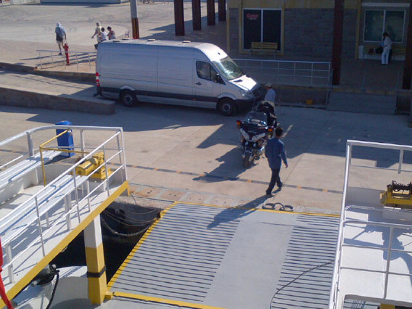 The Animalcouriers van parked outside customs, where courier M is being processed