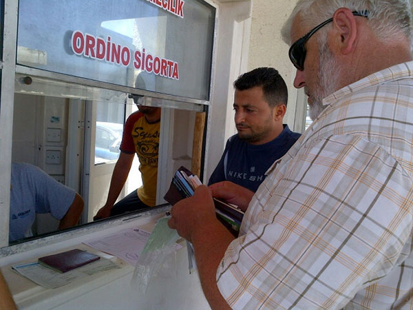 Our agent in North Cyprus, Mustafa, with courier M, starting the process of getting back in