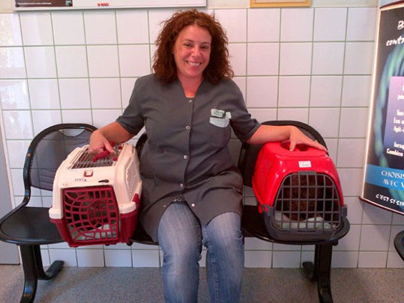 Happy and Maya with the kind veterinary nurse who's been looking after them