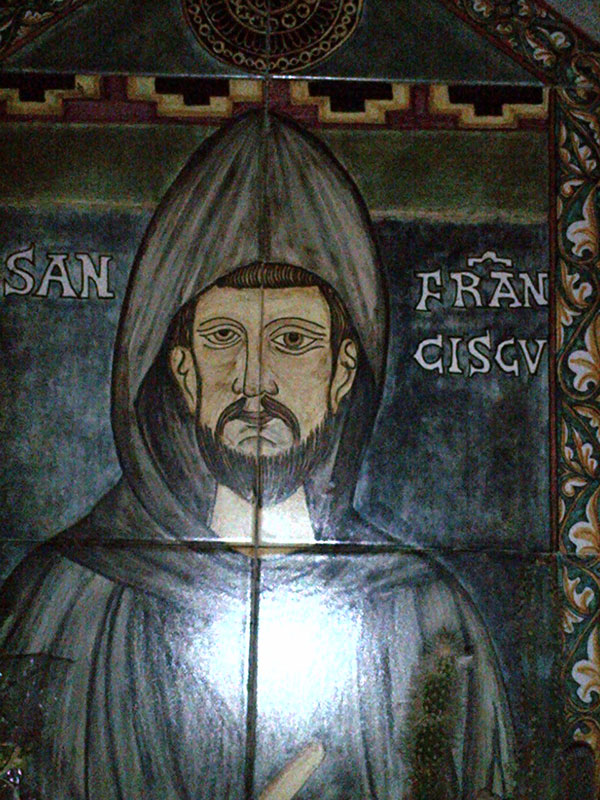 We overnighted under the watchful gaze of St Francis of Assisi — we've told the dogs and cats how lucky they are! This fine depiction is in Basilica of San Francisco and if we stretch our arms out a very long way, we can almost touch it.