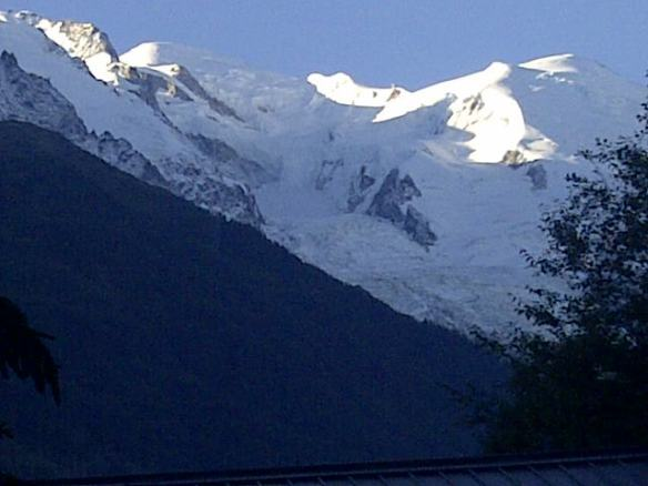 The sun shining down on Mont Blanc, casting great shadows below