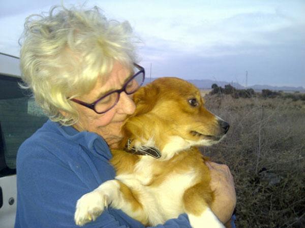 Joan gives Benny a big hug goodbye