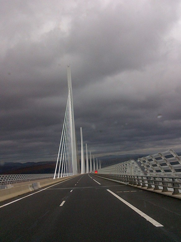 Our journey north yesterday took us over the magnificent Millau Bridge. We first drove over it the week it was open — it impressed us then and still does, creating a flutter of excitement when we spot the red lights on top as we approach it.