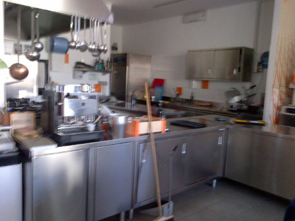 The kitchen is open plan with the restaurant — this morning there was some cleaning going on before the lunchtime crowd appeared