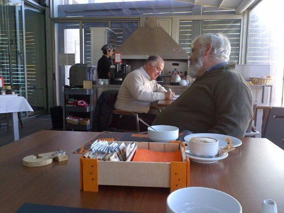 Courier M chatting to our patron at breakfast