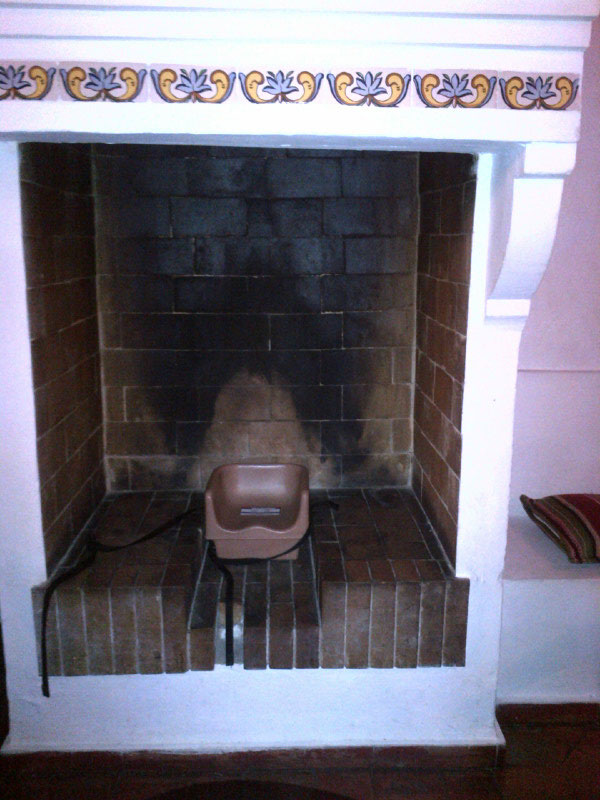 """As some of you worked out, this is indeed a photo of a child's booster seat in a fireplace, spotted at our hotel in Valencia. We were a bit worried at first when we saw it — is it where babies are supposed to eat? Is it where you place naughty children for a 'time out'? Although we were very taken with Gunta's caption suggestion of 'roasted baby', Boomdeeadda's """"Houston, I think we have a problem!"""" tickled our funny bone the most."""