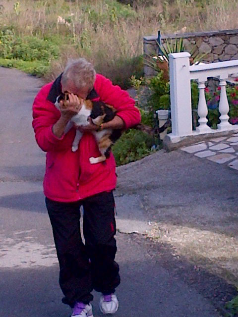 Here comes Cali, safe in Sheila's arms