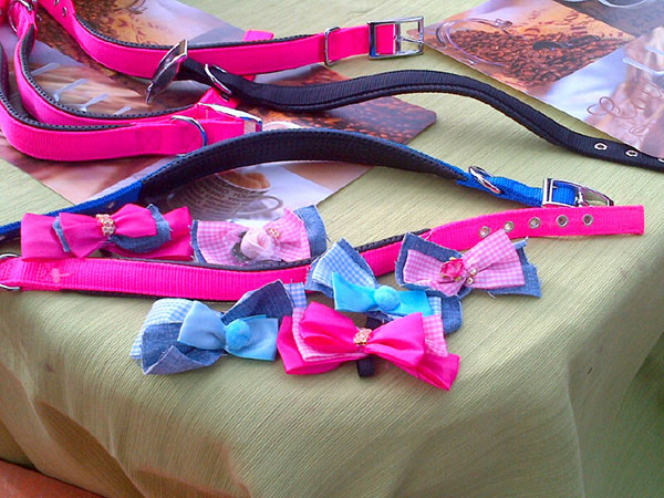 Martha burns the midnight oil making these splendid adornments for the travelling dogs' collars, imbuing them with love and luck for their future lives