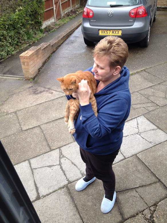 And here's Trouble getting a warm welcome home from his owners