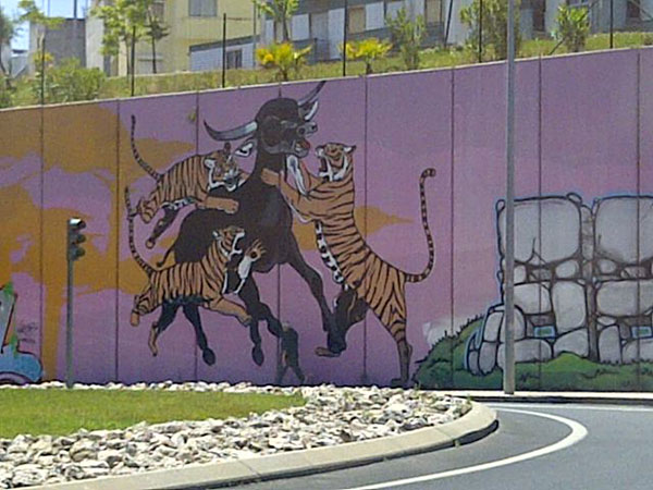 We spotted a couple of fabulous murals while waiting at a red light in Lisbon. This one gives a whole new meaning to The Tiger Who Came to Tea.
