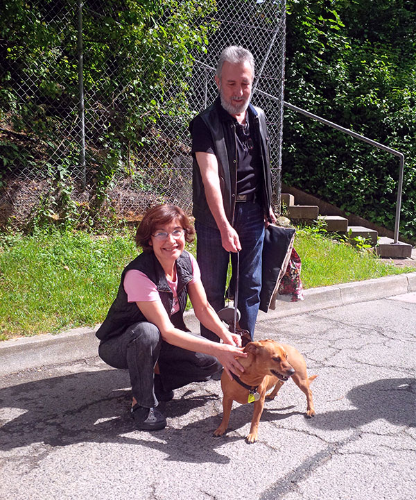 Pepita in the Swiss sunshine with Ines and Jose who've been looking after her since her owner Andy left for the UK