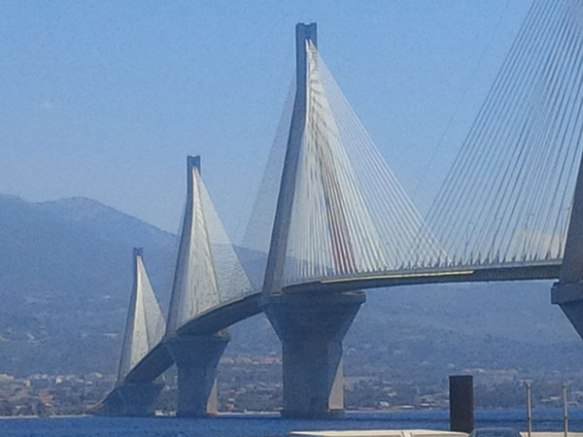 The Rio-Antirrio bridge crosses the Gulf of Corinth and links the town of Rio on the Peloponnese to Antirrio on mainland Greece. The world's longest multi-span cable-stayed bridge, it looks impressive against a bright blue Greek sky.