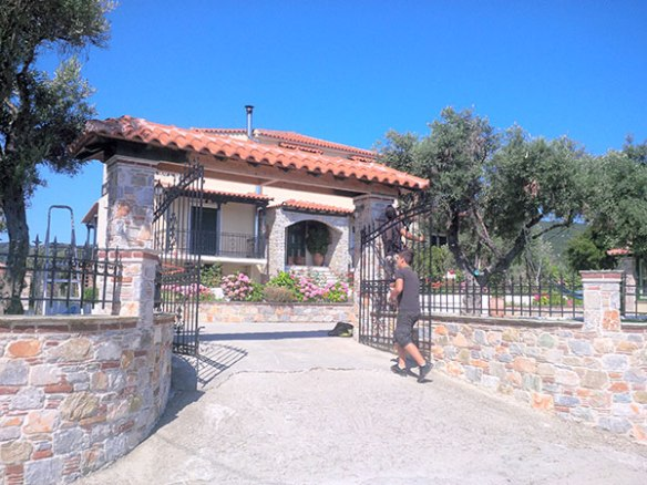 Their lovely house on Skiathos, with a wide blue sky behind