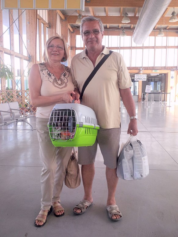 Lola with her grandparents and her supplies for the trip