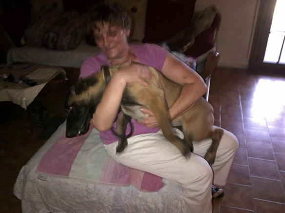 Jacky gets a goodbye hug from her breeder