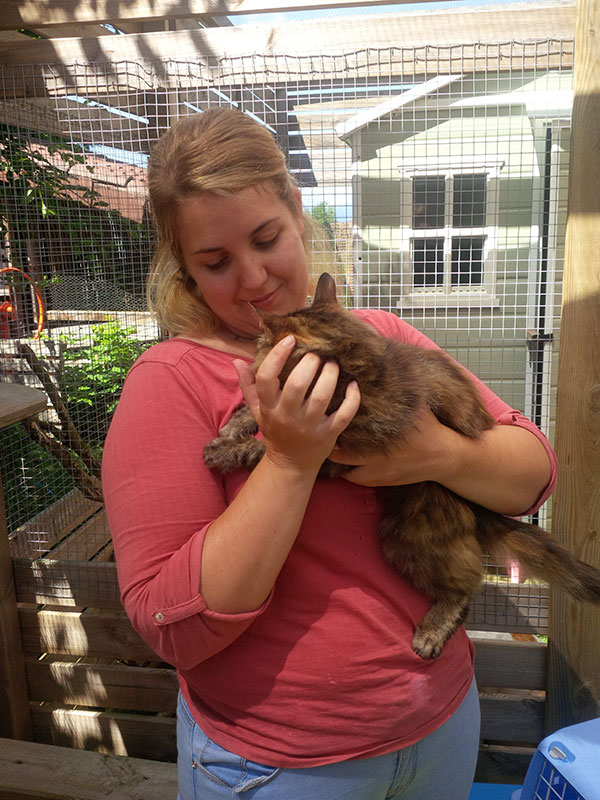 Very sweet and pretty Miss enjoyed a goodbye cuddle with one of the cattery assistants