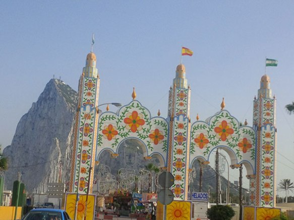 The Rock of Gibraltar, in disguise behind ornate archways set up for the feria