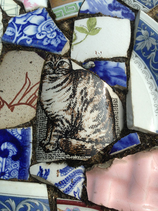 Wonderful cat spotted in among the broken china that decorates the chapel