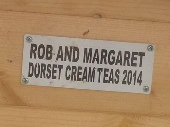 A close-up of the little sign on it reveals that it was donated by lovers of Dorset cream teas!