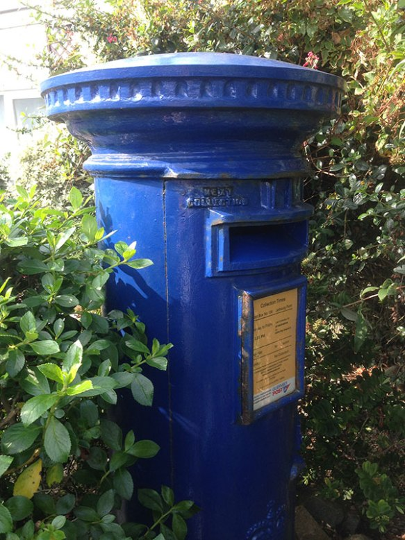 One of Guernsey's iconic blue pillar boxes