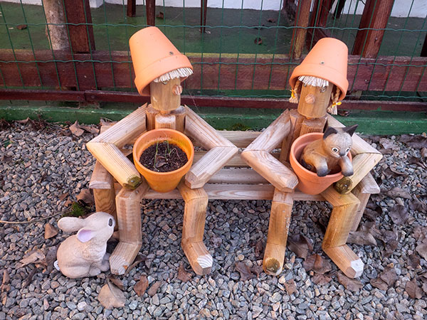 Flowerpot men keep watch over Barbara's cattery, so we know the cats are always safe and well cared for