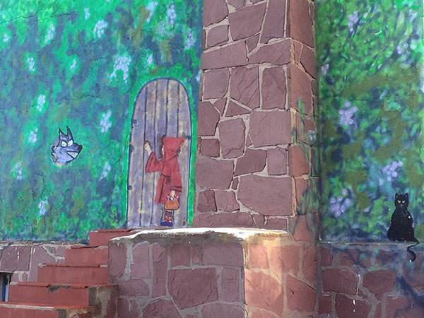 Someone's had a bit of fun here, transforming a derelict cottage into a whimsical Little Red Riding Hood scene