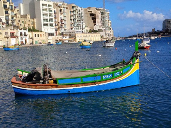 A typical brightly coloured Maltese fishing boat in St Julien's Bay