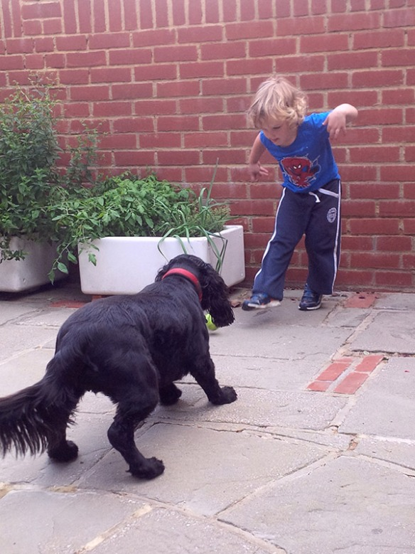 Hector and his three-year old friend sharpen their ball skills