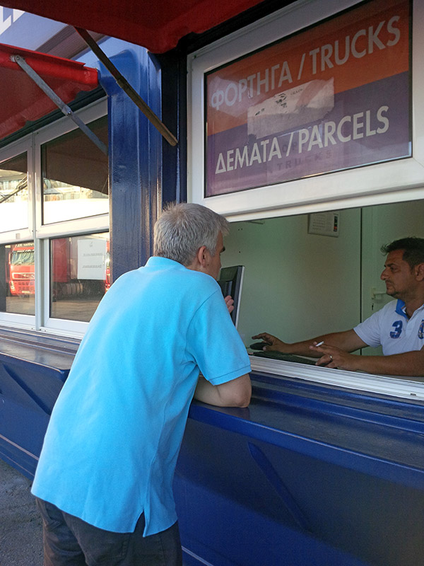 Christos negotiating with the freight department to get a good rate for our van on the ferry to Lesvos. We rely on Christos and Panos of Hellas Ferries to help with all our ferry needs between Italy and Greece, and around the Greek islands.