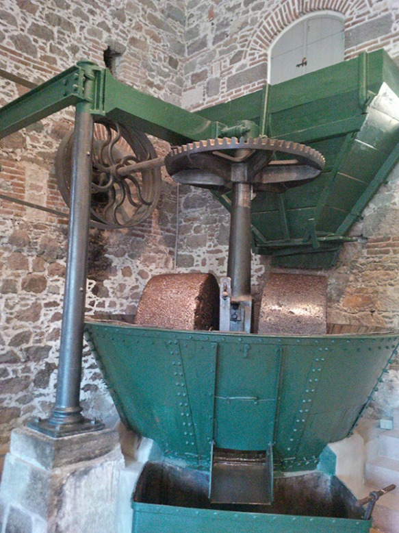 Olives are roughly crushed in the mill, and the resulting pulp is sewn into sacks and taken to the press