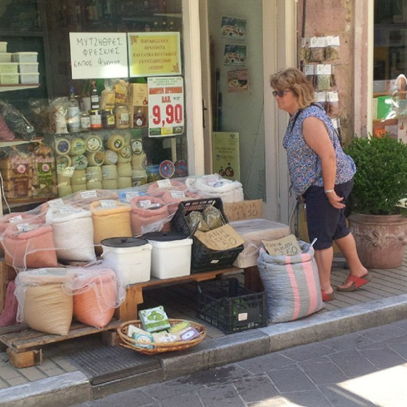 Courier J heads into an interesting-looking shop — she came out bearing olive oil, Lesvos honey and olive oil soap
