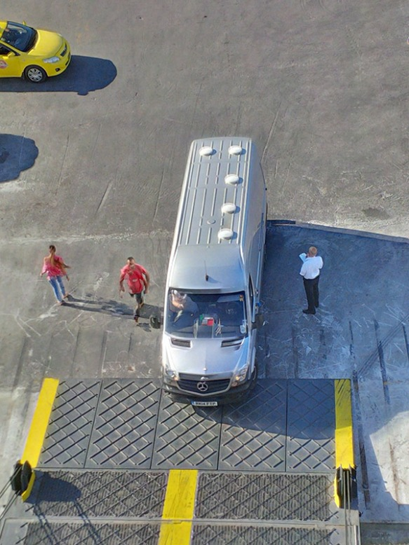 Our van driving up the gangplank