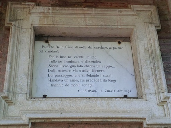 A plaque showing the opening stanza of Leopardi's best known work, Zibaldone, which reads, 'Palazzo Bello, a dog's bark in the night, comes from the farmhouse, with the passing traveller... ' Very apt as the farmhouse is now the Cantina di Ale!