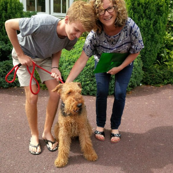 Airedale Spud delighted to be back with his family