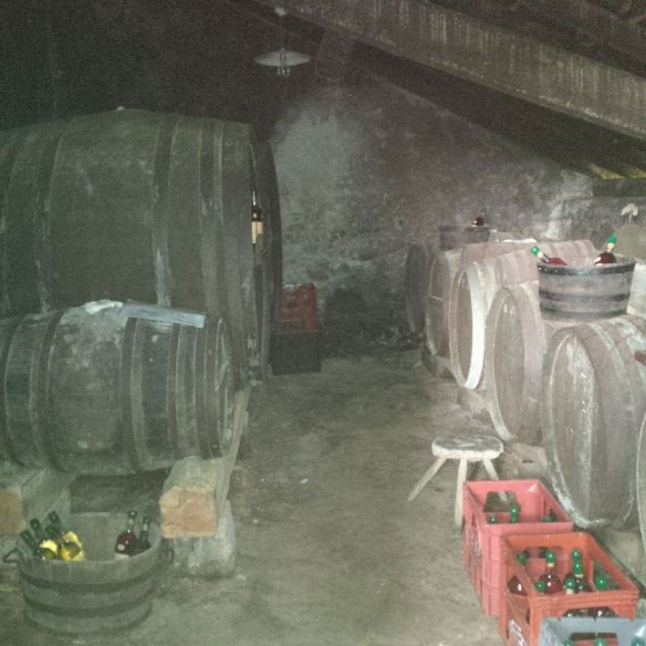 Inside the cave where, once the raisins are soaked, fermented and distilled by the couple, the resulting liquid is left to ferment — it all takes place in this tiny damp little shed.