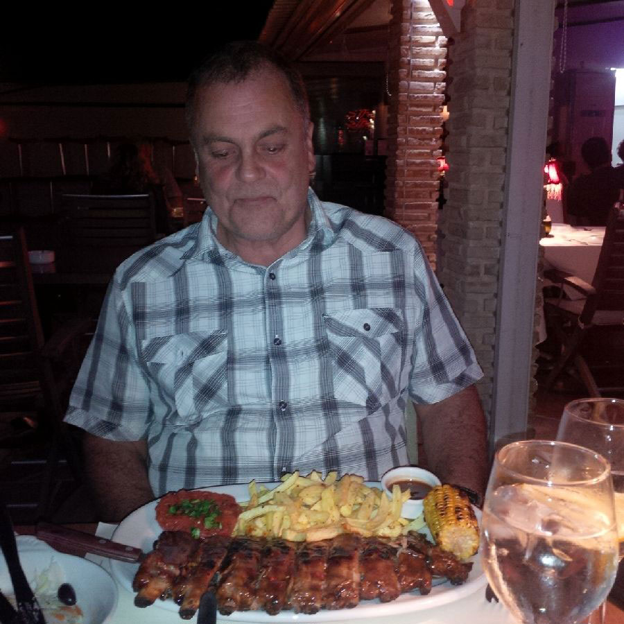 Man versus food — man (Courier Mike) won this time (well, he managed all the ribs, anyway!)