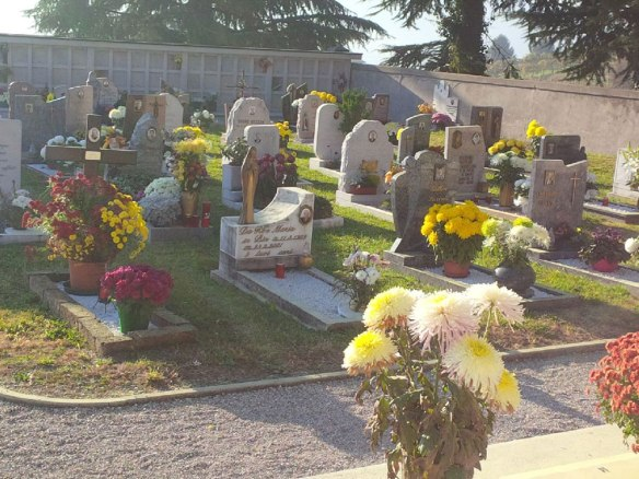 An Italian village cemetery filled with flowers to mark All Saints' Day, which is taken very seriously in continental Europe (Hallowe'en being a very recent import)