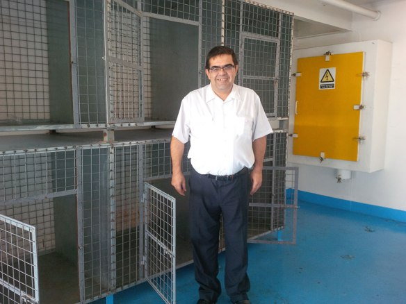Mike, a member of the ferry crew, kindly lending a hand at the onboard kennels. All the crew were really helpful, and let courier J prepare the cages on the outbound trip so they would be ready to house the dogs on the way back to Piraeus.