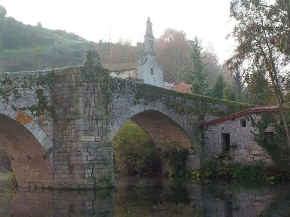 The Vilanova bridge crosses the Arnoia river, and the parish church is just behind